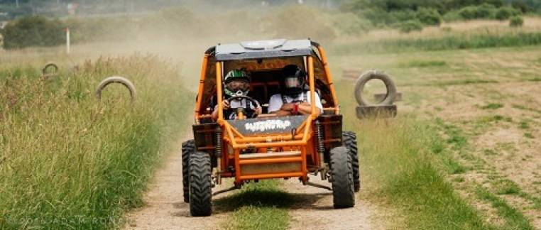 two people in orange buggy