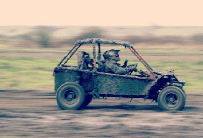 buggy travelling over waste ground