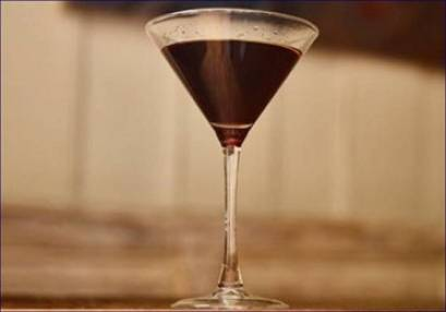 cocktail glass with chocolate colour drink