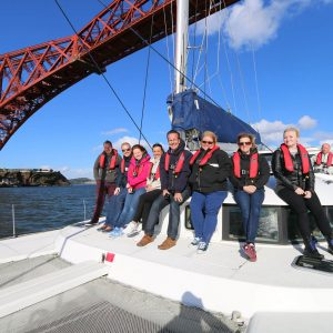 Group having fun on a yacht in Firth of Forth