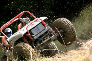 Off road buggy driving on rough terrain