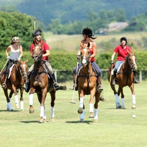 ladies playing polo