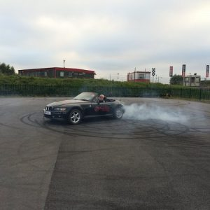black open top car spinning turns