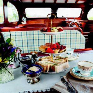 afternoon tea set up inside a vintage boat