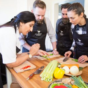 people cutting vegetable at a cooking class
