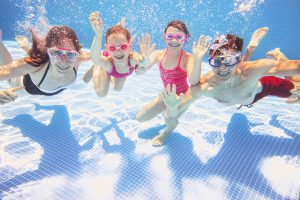 kids smiling underwater