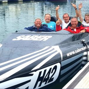 happy passengers in a Powerboat