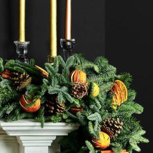 Christmas wreaths on fireplace