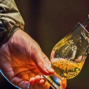 whisky being poured a glass