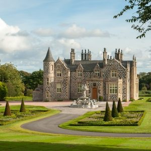 granite mansion in landscaped garden