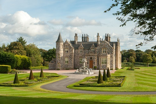 granite mansion in landscaped garden