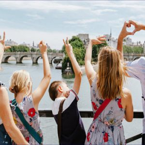 a family on a bridge in Paris