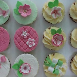 pastel coloured cup cakes