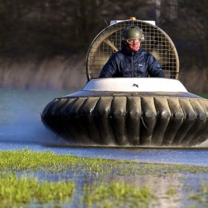 man in a hovercraft on the water
