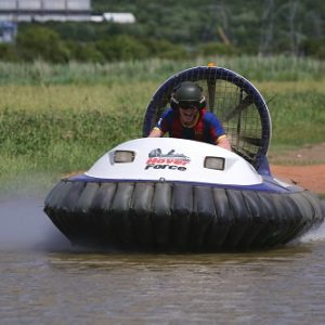 white hovercraft on the water