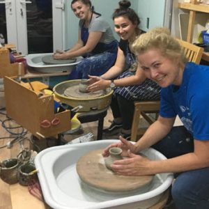 ladies at a pottery making class