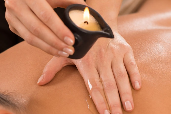 lady getting a candle massage