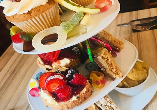 afternoon tea for kids with cakes and sweets