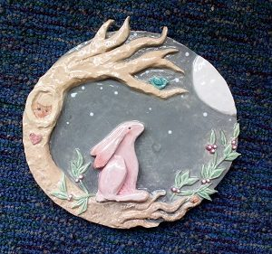 clay ornament of a rabbit and tree