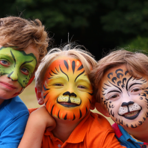 3 boys with there faces painted like animals