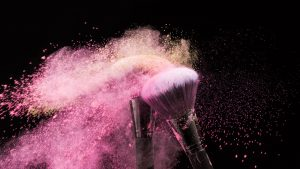 make up brushes with powder on them