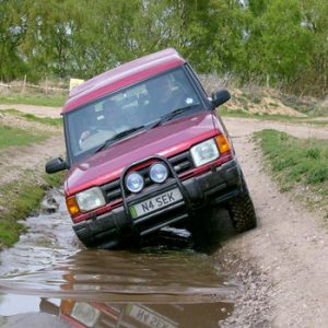 red land rover driving off road