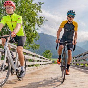 2 cyclists crossing a bridge
