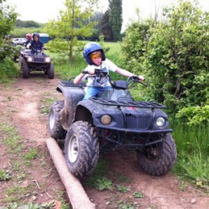 boy on blue quad bike