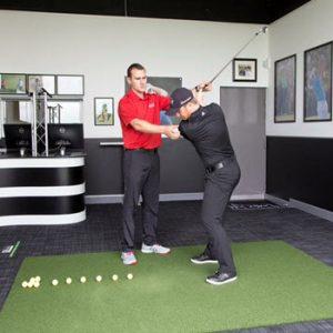 man learning to swing golf club