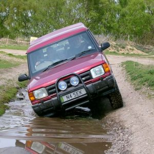 Red Land Rover off road driving