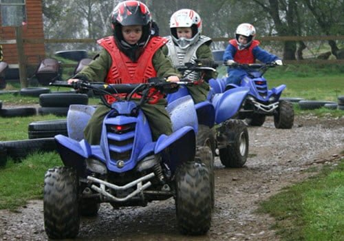 3 boys on boy quad bikes off road driving
