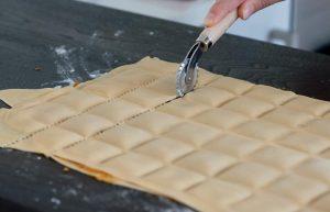 pasta cutter cutting fresh pasta
