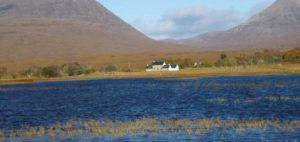 White house at edge of Scottish loch