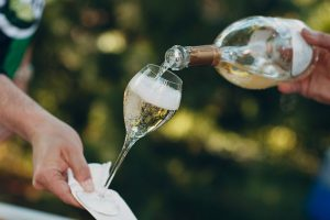 Sparkling wine being poured into a champagne flute