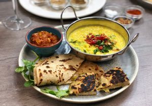 Indian meal plater Dahl, paratha bread & masala chutney