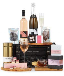 bottles of win, glasses of wine, truffles, box of tea, black box