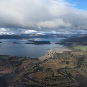 aerial day view of loch and countryside