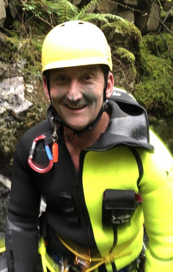man in full climbing safety equipment