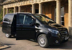 black mercedes mpv luxury van