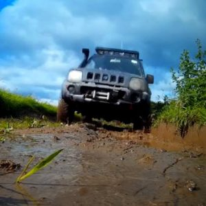 jeep in ditch and puddle