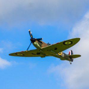 aerial view of war plane display flying in blue sky