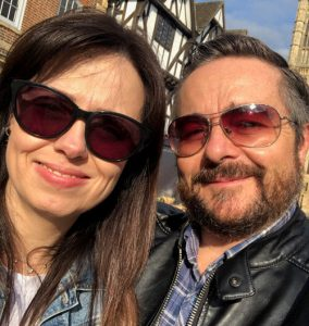 woman with sunglasses on and man with sunglasses on on a sunny day