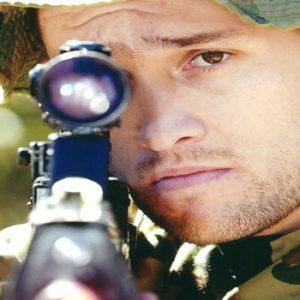man with gun to eye